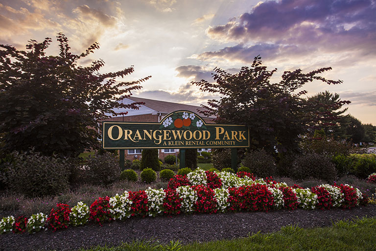 Entrance sign to Orangewood Park Apartments in Levittown